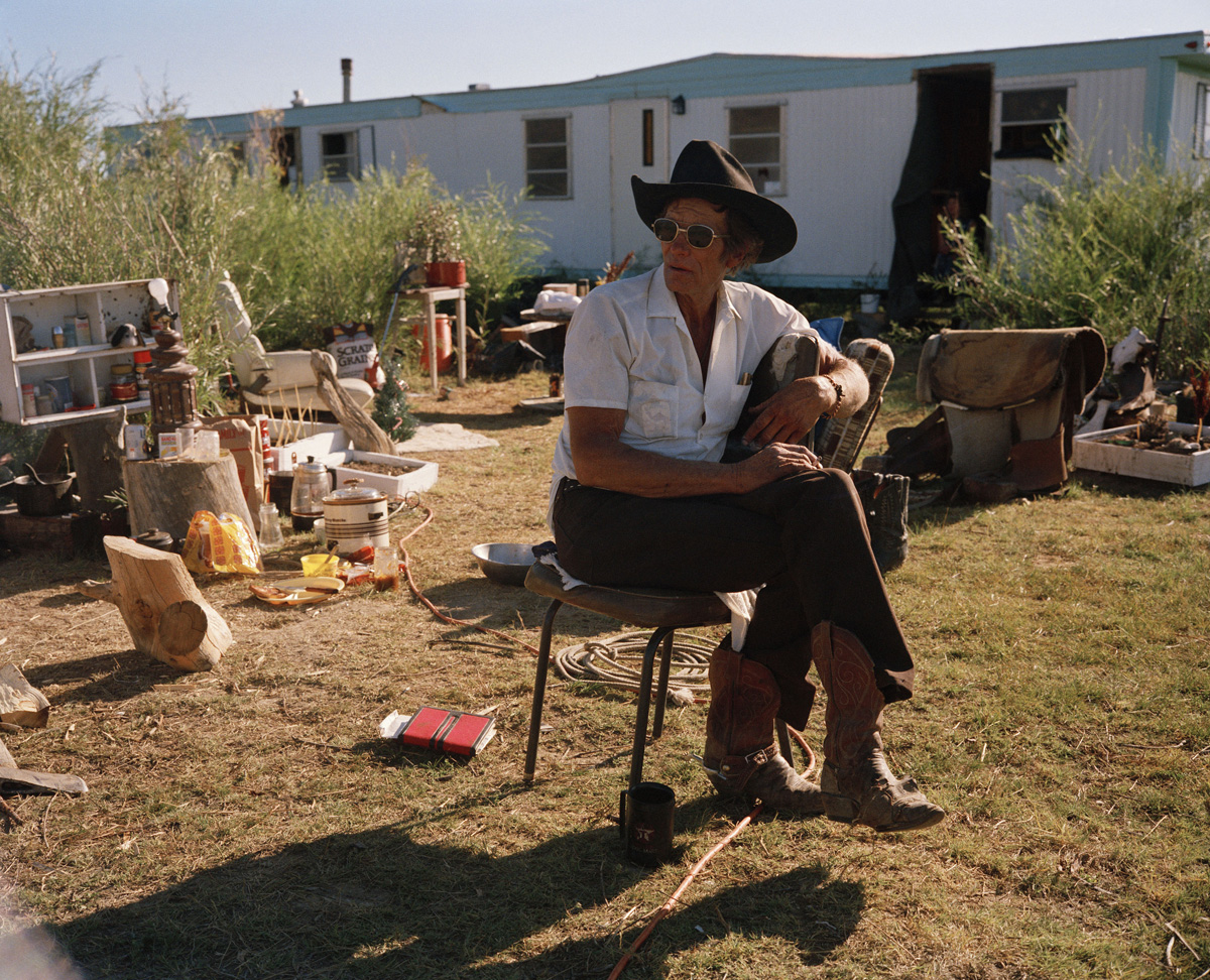 Cowboy Surrounded by Junk